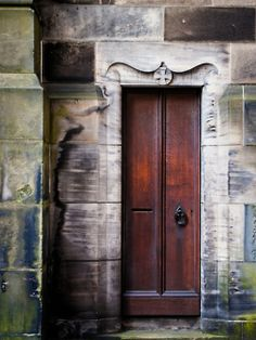 ... looks like this door belongs in some magnificent and mysterious old castle... could even be a door at Hogwarts...  LOL