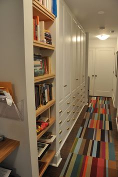 City apartment living often means long hallways. Love these built-ins! From the Living With Kids Home Tour featuring Amy Dolgin.