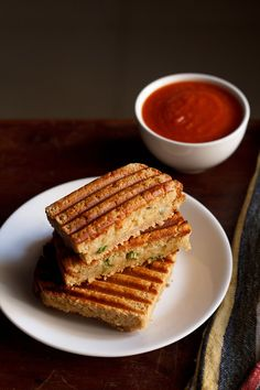 aloo masala grilled sandwich recipe - to make these grilled sandwiched with a spiced potato stuffing is very easy. all you need are some boiled potatoes, spices, butter and bread.