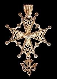 Hugenot Cross. In the Family mythos, we are desended from a french aristocratic house that went protestant. we are proud french protesants!