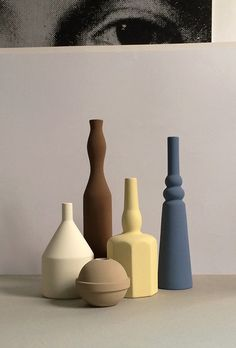 Le Morandine V., designed by Sonia Pedrazzini, is a collection of hand-painted ceramic jars, jugs, and vases inspired by Giorgio Morandi's still life paintings
