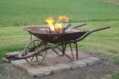 Old metal wheelbarrow repurposed into firepit - awesome for a s'mores bar until the rusty hole burns through and HEY FIRESPLASH! MY SHOES ARE ON FIRE BRB