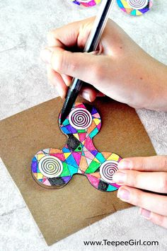 Color and make your own fidget spinner! This DIY fidget spinner is great for keeping kids busy and happy! The kids love it because they get to decorate their own fidget spinner. The adults love it because It's easy and comes together quickly. Get the full instructions and free printable at www.TeepeeGirl.com.