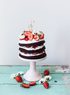 Midsummer chocolate cake with whipped coconut cream and strawberries.