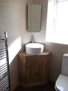 Corner basin units are ideal for en-suites and smaller bathrooms.