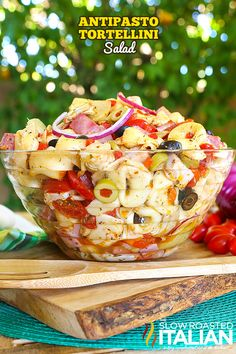 My latest summer obsession is a fusion of your favorite antipasto together with a pasta salad that is tossed with an amazing homemade zippy Italian dressing that will make your tastebuds sing. This easy recipe for Antipasto Tortellini Salad will become your new favorite. I can't stop eating it, it's so good!   #ad @starfinefoods