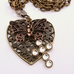 Filigree Brass Heart with Copper Butterfly by SilverStringsStrands, $24.00