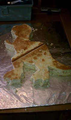 The start of Rex, from Toy Story. Part 1 saga. The cake was not cooked through! GACK! But the template was awesome! Pulled it off the web and had it blown up at Kinko's.