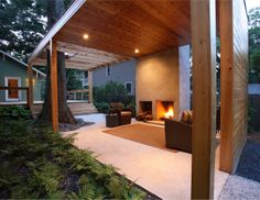 "From dwell.com.  The outdoor living room features a fireplace inspired by Frank Lloyd Wright's Usonian ""heart of the home"" hearth philosphy."