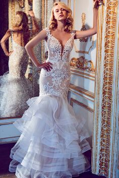Wedding gown by Calla Blanche.