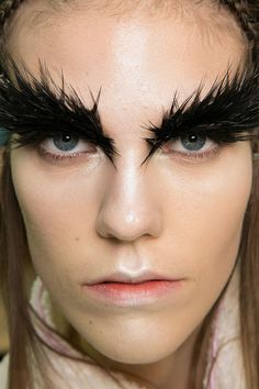 The feathered lashes were tres dramatic at the Alexander McQueen Fall 2014 Paris Fashion Week show! #PFW