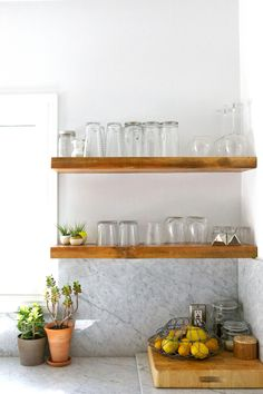 Minimalist Home Interior open shelves in white kitchen.Minimalist Home Interior open shelves in white kitchen Kitchen Shelves, Wood Shelves, Floating Shelves, Glass Shelves, Corner Shelves, Kitchen Cabinets, Floating Wall, White Cabinets, Kitchen Storage