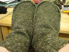 Upcycle an old wool sweater into awesome cozy slipper socks. Add puffy paint to the bottom for non-slip grip. Guess what everyone is getting for christmas! :)