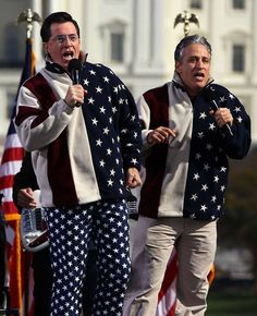 Comedians Steven Colbert and Jon Stewart perform dressed in American flags at the Rally To Restore Sanity And/Or Fear on the National Mall on October 30, 2010 in Washington, DC.