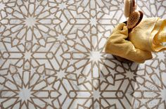 Castilla, a natural stone waterjet and hand cut mosaic shown in Jura Grey honed and Calacatta Tia polished marble, is part of the Miraflores Collection by Paul Schatz for New Ravenna Mosaics.