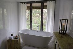 I love how deep this tub is...and the lovely view of nature. I'm relaxed just thinking about it.