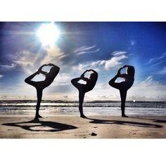 Triple person yoga pose