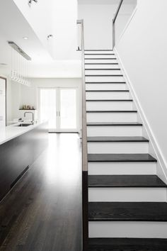 sleek black + white contemporary kitchen, stairway black treads, white risers, architecture