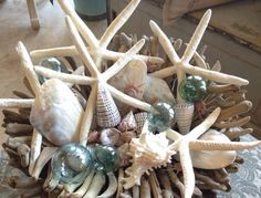 Starfish and shells?  Yes please!! #coastalliving #housebeautiful #seasidehome