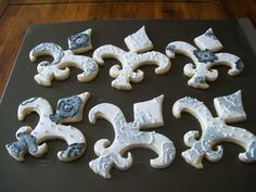 fluer de lis cookies - These were also for my daughter's prom. Sugar cookies with royal icing and embroidered flowers