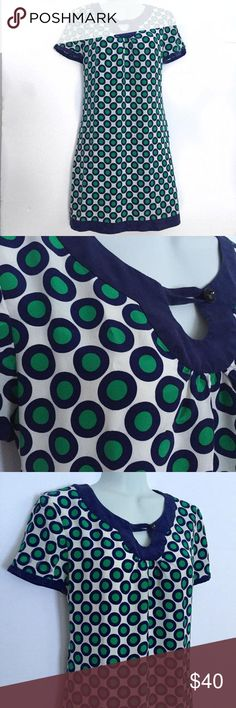 Tibi white shift dress with green and blue polka dots This designer dress is in great condition, has a manufacturer flaw on the sleeve (a few of the polka dots color is running/bleeding), as pictured, not that noticeable when worn. Tibi Dresses Midi