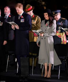 Meghan Markle took part in her first official service of remembrance as she joined her fiancé, Prince Harry, at an Anzac Day Dawn Service