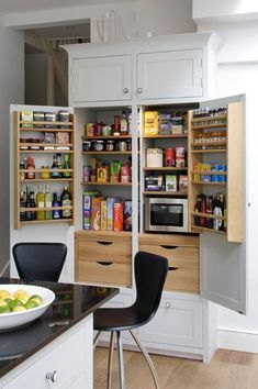 Love the door shelving- I wonder if our cabinets would be strong enough... Beautifully Organized (& Clever!) Pantries