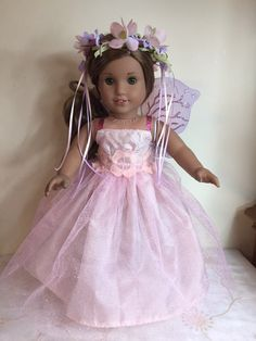A personal favorite from my Etsy shop https://www.etsy.com/listing/504074177/american-girl-custom-pink-sparkle-fairy