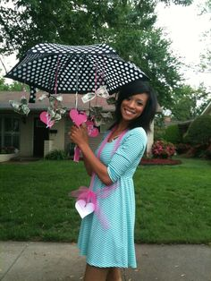 """Bridal Shower gift I made. Money tied onto an umbrella with ribbon and hearts cut out with the cricut. Heart attached to the handle of the umbrella read """"showering your marriage with love and financial blessings."""""""