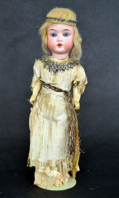 Antique Christmas Fairy with bisque doll head, glass eyes, mohair wig...fragile crepe paper dress