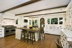 More space than I'd ever need, but I love these beams, wood floors, windows, and the stove