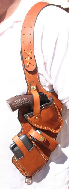 Shoulder holster for pistol, knife and phone.