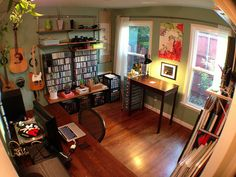 home office, music studio, and art studio, via Flickr. Close to what I need from my front room, but sub dance for art.