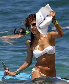 Alessandra Ambrosio paddle boarding