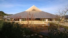 Huge sculptural roofs made from cypress wood provide shelter for this community centre and hall, built by architect Hiroshi Sambuichi on a Japanese island