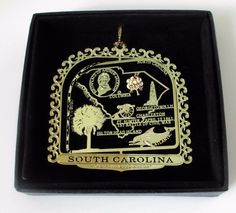 South Carolina State Landmarks Brass Ornament Black Leatherette Gift Box #ILoveMyState -  Start a family tradition of collecting ornaments for places you've lived or visited.  It makes for sentimental memories when you hang them on the Christmas tree each year and remember that special time in your lives.  Many of our customers collect the same ornaments for their children's hope chest, so they will have a meaningful gift to give them when they move into their first apartment or home.
