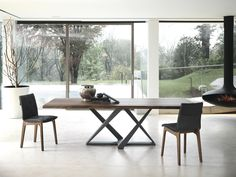 """Beautiful dining table featuring an anthracite base and a 1.6"""" thick live edge Walnut solid wood top. Made in Italy."""