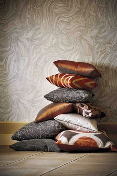We love cushions, especially when they are in copper and orange tones! Fabrics from Harlequin's Momentum 6 collection.