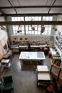 An open workshop type interior that has plenty of room for space of large tables and walls to display work, signs and use as an art and craft like studio for school work, teaching, personal hobby or for an actual career.