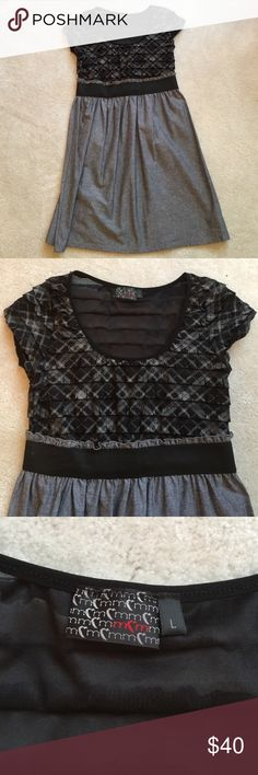 Never been worn Grey and Black ruffle dress! A beautiful grey and black scoop neck dress with ruffles at the top and a grey belted skirt at the bottom. Has never been worn! MCM Dresses Midi