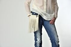 Leather hip bag with fringe : one bag, many styles! The front part is removable : Let your bag truly shine by selecting beautiful hues and vibrant metallic leather accessories to match! Be creative..