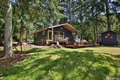 528 square feet waterfront cabin in Langley, Washington - Fire Pit / Fireplace in a Living Area on the Deck / Patio / Porch - House Exterior Stairs to Garden / Yard Tiny Cabins, Tiny House Cabin, Lake Cabins, Cabins And Cottages, Cabin Homes, Bungalow, House With Balcony, Exterior Stairs, Harbor House