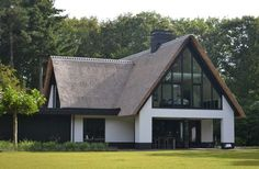 Contemporary traditional house with thatch roof.