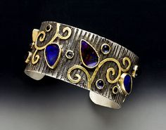 Cuff by Laurie MacAdam - Boulder Opal, Iolite, 18k gold, silver     Photo by Bernard Wolf