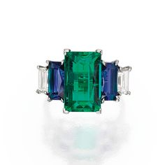 PLATINUM, EMERALD, SAPPHIRE AND DIAMOND RING. Centered by a rectangular step-cut emerald weighing carats, flanked by two rectangular step-cut sapphires weighing and carats, further accented by two baguette diamonds weighing Jewelry Rings, Fine Jewelry, Jewelry Box, Emerald Jewelry, Emerald Rings, Emerald Cut, Ruby Rings, Tungsten Wedding Bands, Wedding Rings