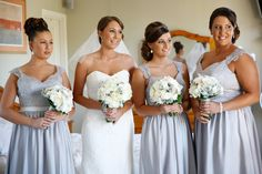 The perfect white wedding with perfect white bouquets. Hydrangea, roses, lisianthus, silver suede.