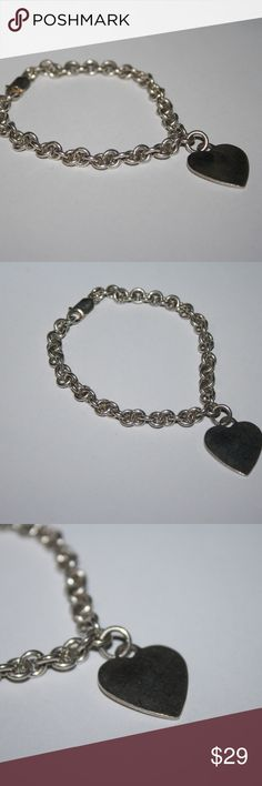 Tiff style Heart charm bracelet .925 Stamped .925 7.5 inches long. Heart charm. Nice heavy chain! Buy from me with confidence! I have sold over 400 items with a 5 star rating! If you have any questions, do not hesitate to ask.  Looking at a few things in my shop? Put a bundle together, comment on an item that you are ready to check out and let me send you an even better offer!  Thank you for visiting :) Free gifts with every purchase! Jewelry Bracelets