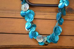 video tutorial on how to make a button necklace.  Much better than the directions on marthastewart.com