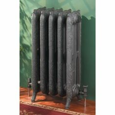 Skinny trad rads http://www.ukbathrooms.com/shop/radiators/traditional_radiators/products/aestus_versailles_column_radiator_750mm_high.html  can be only 3 sections at 234mm wide