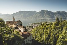 First sun rays over Locarno and its wonderful church called Madonna Del Sasso. #switzerland #lake #ticino #sunrise #light #summer #water #nature #view #travel #city #mood #InLoveWithSwitzerland #locarno